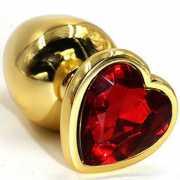 Стеклянные и металлические: Золотистая анальная втулка с кра...