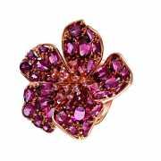 Кольцо из розового золота 585 пробы с сапфирами и родолитами...